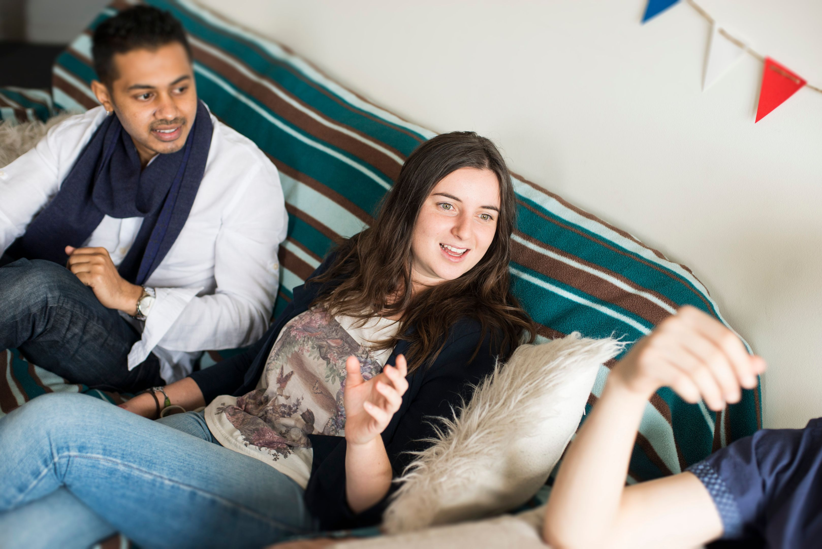 Two students sitting on a couch at on-campus accommodation